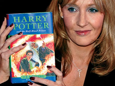 British author JK Rowling poses with a copy of her new book
