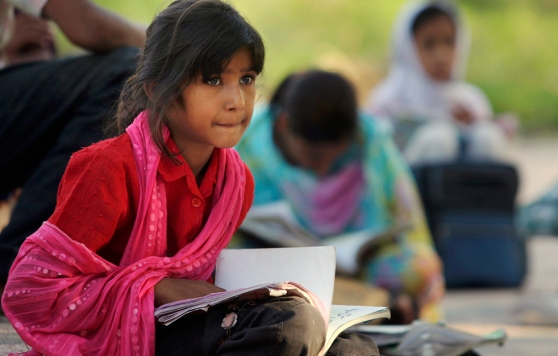 A Pakistani girl attends a makeshift class at held at a park and organized by volunteers on International Literacy Day, in Islamabad, Pakistan, Tuesday, Sept. 8, 2009. According to UNICEF, only 56% of Pakistani children attend primary school, and 55% of adults are literate. (AP Photo/ Anjum Naveed)